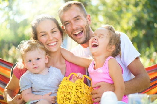 Happy joyful young family with children