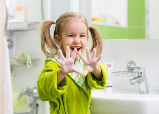 child washing hands